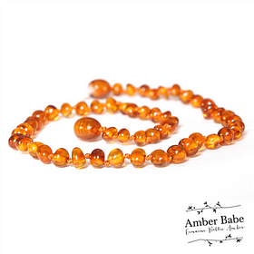 Amber baby teething necklace in a light brown honey colour